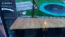 """Storm Dennis """"repairs"""" fence it blew down at UK home"""