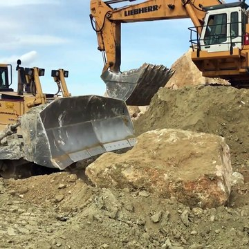Cat D8T Dozer Pushing Huge Rocks[1]