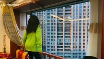Quarantined Chinese citizens take part in dance battle on their balconies during COVID-19 outbreak