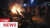 Fearing infection, residents protest coronavirus evacuees landing in Ukraine