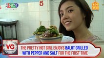 The pretty hot girl enjoys balut grilled with pepper and salt for the first time