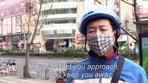 China's couriers take hands-off approach amid virus