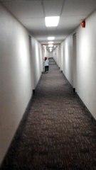 My Son Running Down The Hotel Hallway