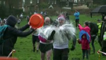 Wife carrying championship takes place in Surrey