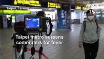 Coronavirus: Temperature checks in Taiwan metro