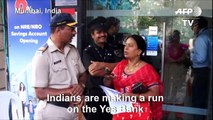 Customers of India's Yes bank queue after withdrawals limited