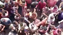 Indian festival-goers throw human ashes at each other in strange ritual