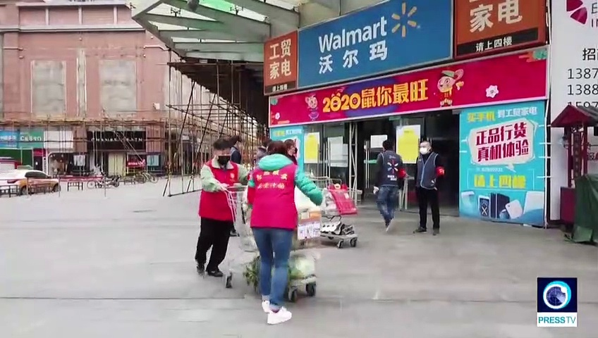 Wuhan residents go shopping as new coronavirus cases in China subside
