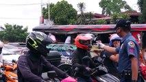 'No work, no pay' workers grind despite traffic, coronavirus threat