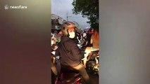 Drivers pass through checkpoints during coronavirus lockdown in Manila