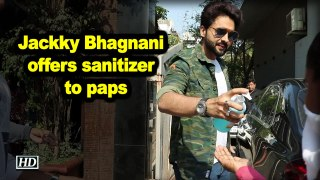 Jackky Bhagnani offers sanitizer to paps