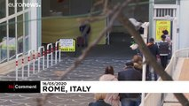 Coronavirus: Italians comply with social distancing rules outside supermarket