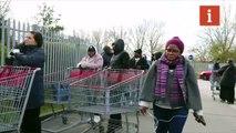 People queue outside Costco Wholesale store in Chingford, London as coronavirus prompts fears of lockdown