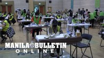 Seoul mask production line overwhelmed by volunteers