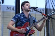 Niall Horan doesn't talk to 1D bandmates about music