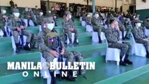 Members of Philippine army practice social distancing at AFP Headquarters in Taguig