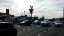Customers queue to grab their last McDonald's before chain closes its drive-thrus across the UK