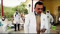 امرأة عراقية ستينية ترقص فرحا بشفاء زوجها من كورونا