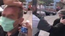 Yaşlı adamı zorla durdurdular, maske takıp başına kolonya döktüler