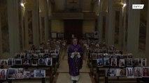 Italian priest holds mass in front of selfie printouts amid coronavirus lockdown