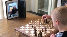 Kid Plays Chess With Grandfather Over Facetime