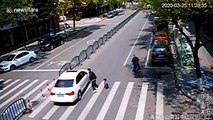 Chinese father's quick reactions save son from being run over by car at crossing