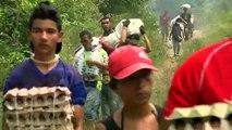 Des Vénézuéliens défient virus et confinement pour s'approvisionner en Colombie