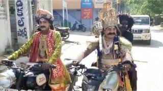 Dhone town, Kurnool district, AP  sees police put drama artistes on corona awareness drive (filing)