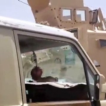 Al-Houthi arrives in Sana'a on-board armored personnel carrier