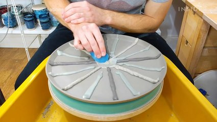 Artist indents clay to make textured pottery