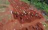 Indonesia's gravediggers battle virus fears