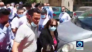 Palestine: COVID-19 survivors give away facemasks and gloves