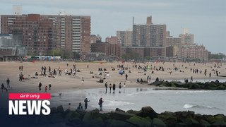 Americans head to beach over holiday weekend while COVID-19 death toll expected to reach 100,000