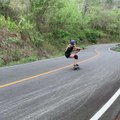 Woman Does Stunt While Skating on Longboard