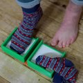 Guy Invents and Demonstrates Usage of Hands-Free Device to rip Socks off One's Feet