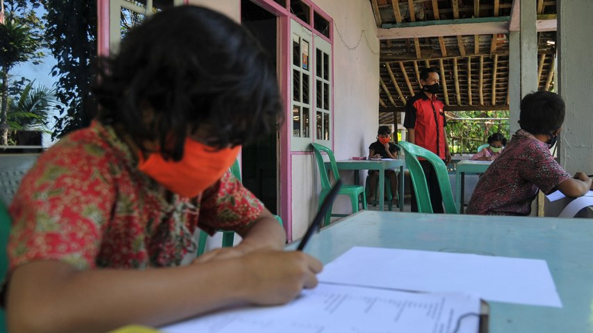 Indonesian teacher brings lesson to village students without internet despite Covid-19 rules