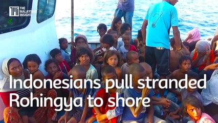 Indonesians pull stranded Rohingya to shore