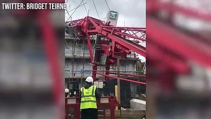 Crane collapses into building in Bow, East London, trapping people in buildings