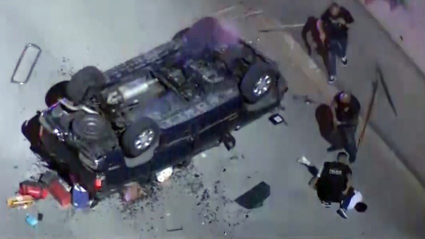Slow speed pursuit ends with suspect driving over ledge