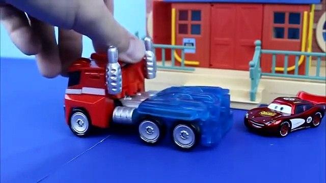 Disney Pixar Cars Lightning McQueen gets saved by Transformers Optimus Prime Bane Joker