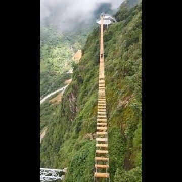 Adrenaline junkie takes on Vietnam's highest wooden suspension bridge