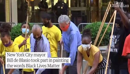 New York City mayor helps paint Black Lives Matter mural outside Trump Tower – video