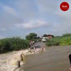 Dramatic escape for two as car gets washed away in Andhra's Anantapur