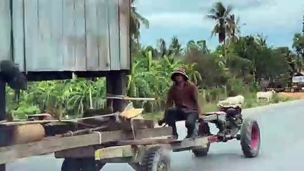 House moved by being driven away on tractors