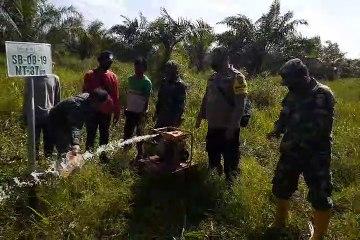 Pengecekan Sumur Bor Badan Restorasi Gambut  di Muntialo