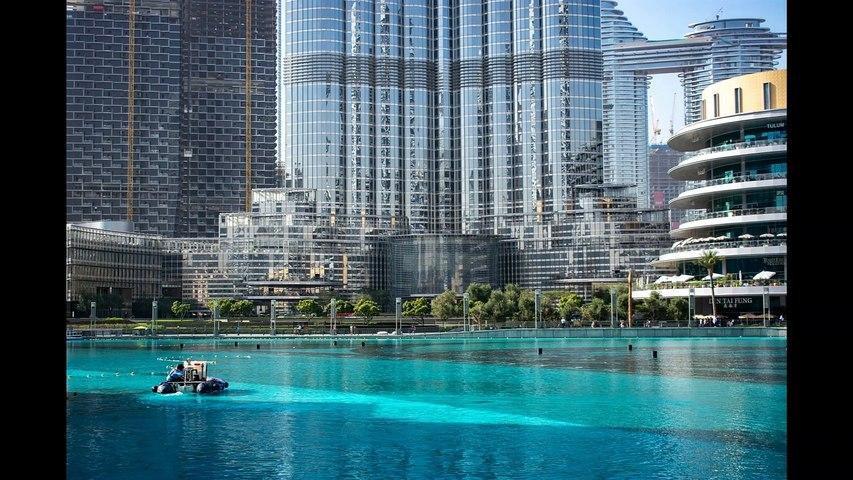 Welcome to Burj khalifa Dubai UAE - United Arab Emirates - man & camera