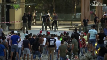 Beirut: protesters clash with police outside Lebanon's parliamentary precinct – video