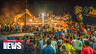 At least 100 feared trapped as apartment building collapses in India