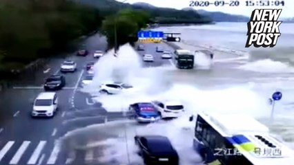 Tidal wave! Gushing river at high tide sweeps cars off road