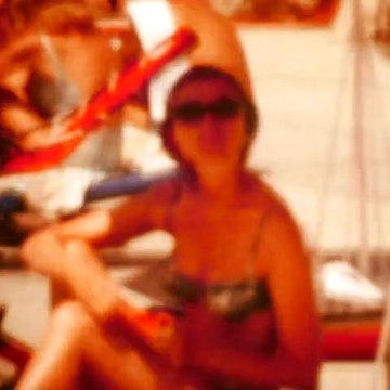 sexy woman in swimsuit reading on beach old home 8mm footage